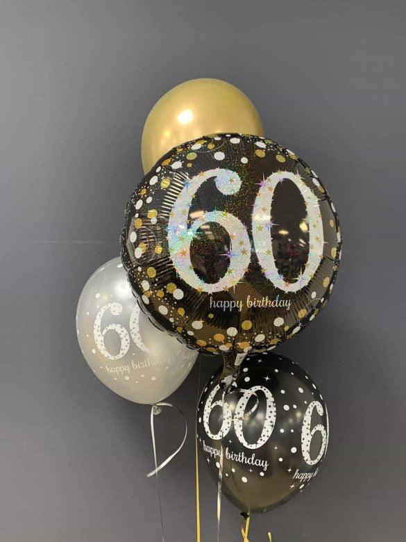 Happy Birthday 60. € 5,90<br />Ballon Latex gold € 2,30<br />Latex mit Druck € 2,20 78